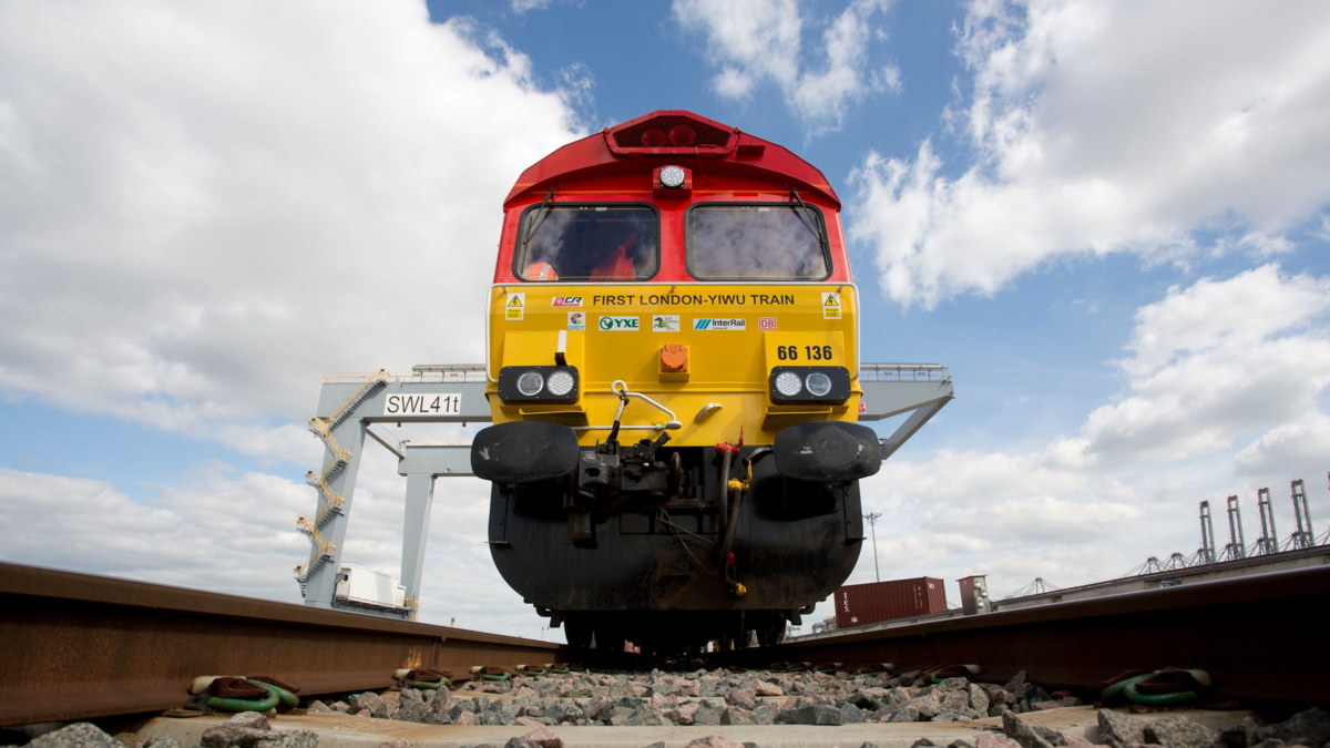 The image shows a freight train departing from London on the way to Zhejiang