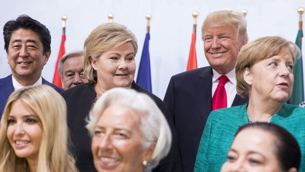 The image shows Norwegian Prime Minister Erna Solberg with Shinzo Abe, Donald Trump and Angela Merkel at the G20 meeting in 2017.