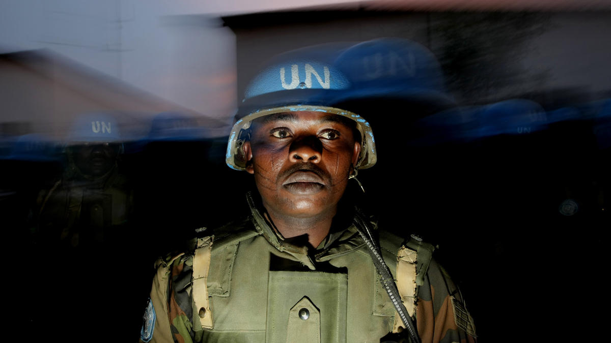 The image shows a UN peacekeepier