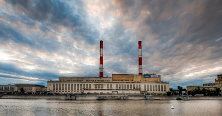 The image shows a Gazprom facility by the Moscow River.