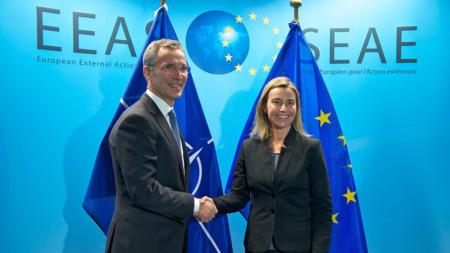 The image shows Jens Stoltenberg (NATO) and Federica Mogherini (the EU)