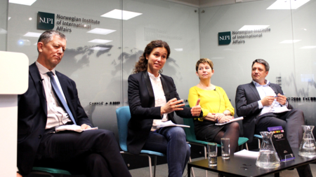 The image shows a panel at a NUPI event