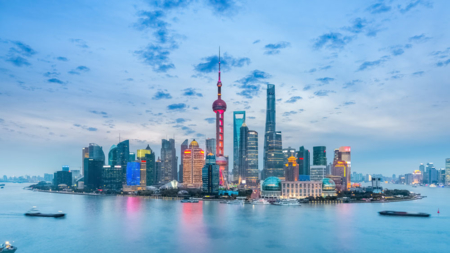 The image shows Shanghai's skyline