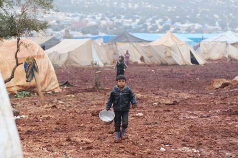 Liten gutt i flyktningleir